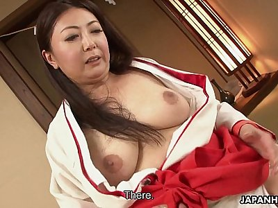 Mature Asian tramp in her kimono tries out two cocks