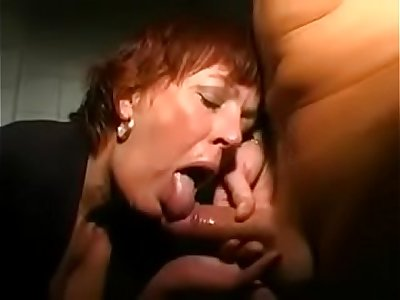 redhead mature in the glory hole