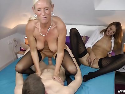 Two Milfs fucked hard with a young Student